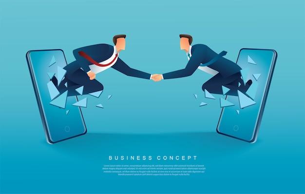 Handshaking degli uomini d'affari che esce dagli smartphone