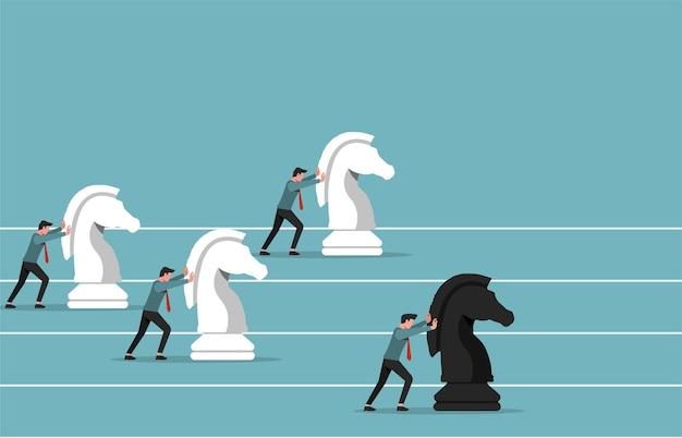 Uomini d'affari che spingono i pezzi degli scacchi del cavaliere per essere un'illustrazione del vincitore