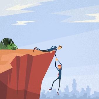 Persone di affari che si tengono per mano cliff support concept