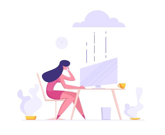 Donna di affari che si siede davanti al monitor con il telefono