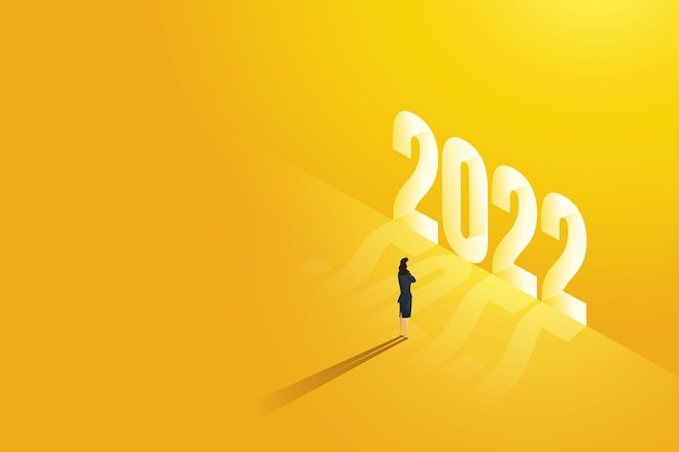La donna d'affari sta davanti a un brillante splendente nel 2022