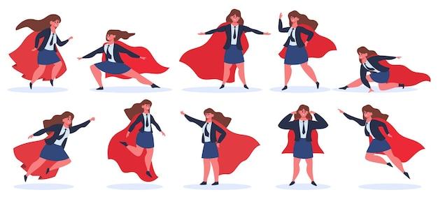 Supereroe della donna di affari. il personaggio femminile del supereroe nell'azione del supereroe pone in mantello rosso