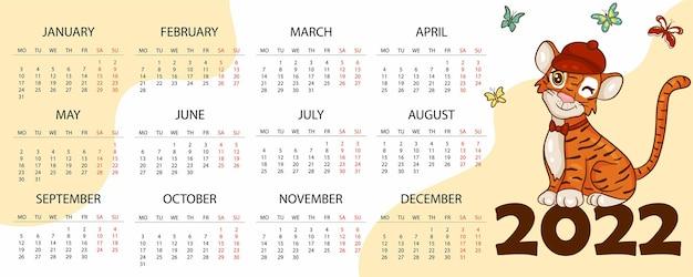 Modello di progettazione del calendario per il 2022, l'anno della tigre secondo il calendario cinese o orientale, con un'illustrazione della tigre. tavolo orizzontale con calendario per il 2022. vector