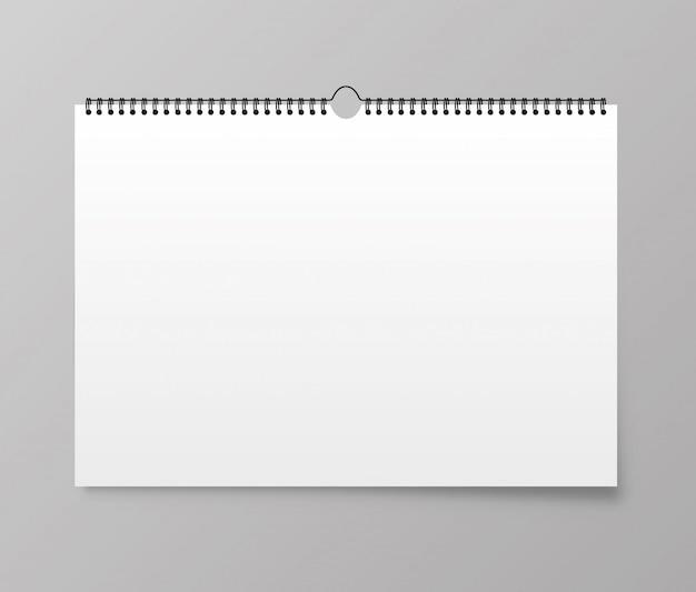 Mockup del calendario. il calendario è appeso al muro.