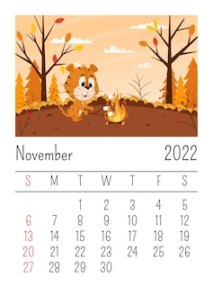 Pagina del calendario per il 2022, novembre. la tigre sveglia del fumetto arrostisce i marshmallow su un falò nella foresta