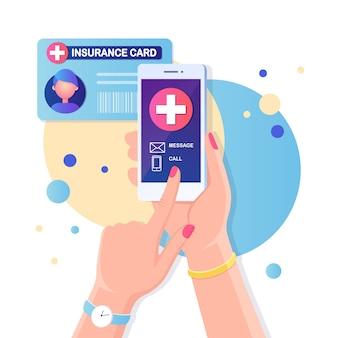 Chiama il dottore, l'ambulanza. tenere in mano il telefono cellulare con croce sullo schermo. tessera sanitaria con croce. documenti medici, carta clinica per la protezione della vita. design piatto