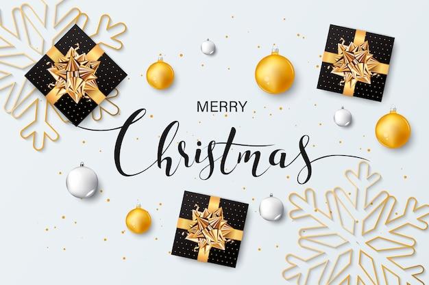 Lettering calligrafico di buon natale decorato con stelle d'oro