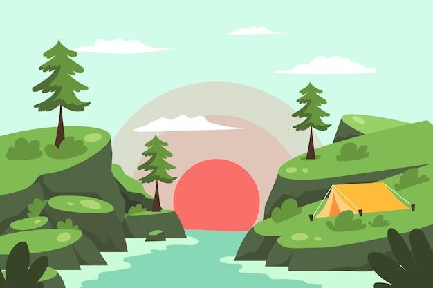Paesaggio di area di campeggio con il tramonto