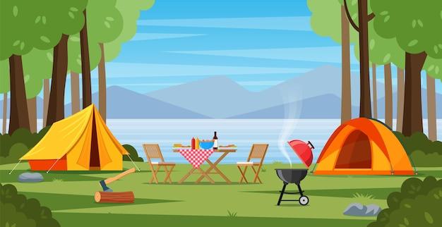 Tenda da campeggio vicino al lago e alle montagne.