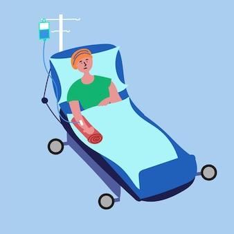 Il malato di cancro giace nel letto d'ospedale sottoposto a procedura di chemioterapia medica