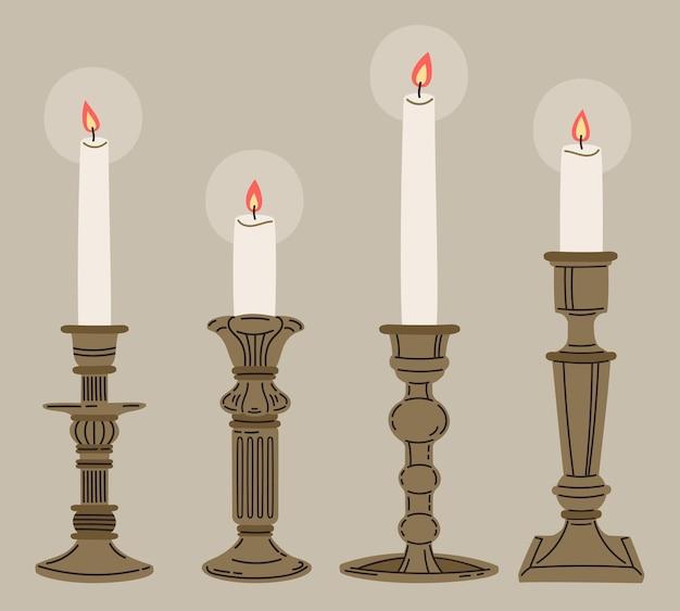 Candele in candelabro vintage e candelieri illustrazione vettoriale set
