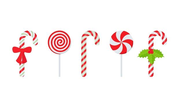 Bastoncino di zucchero. bastoncino di natale e caramelle rotonde. simbolo di lecca-lecca menta piperita isolato