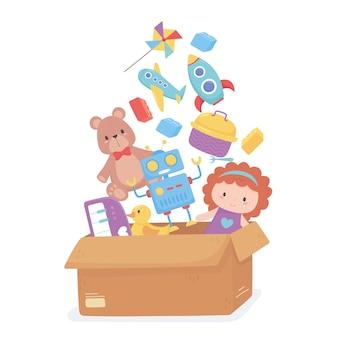 Scatola di cartone piena di oggetti giocattolo per bambini piccoli per giocare a cartoni animati