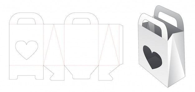 Sacchetto della spesa del cartone e finestra del cuore con il modello tagliato del supporto