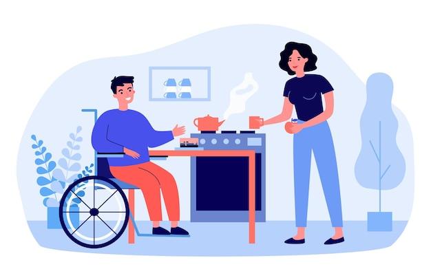 Donna premurosa che prepara la torta per l'uomo disabile