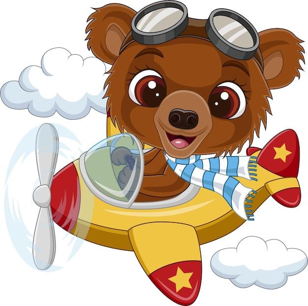 Orsetto cartone animato alla guida di un aereo