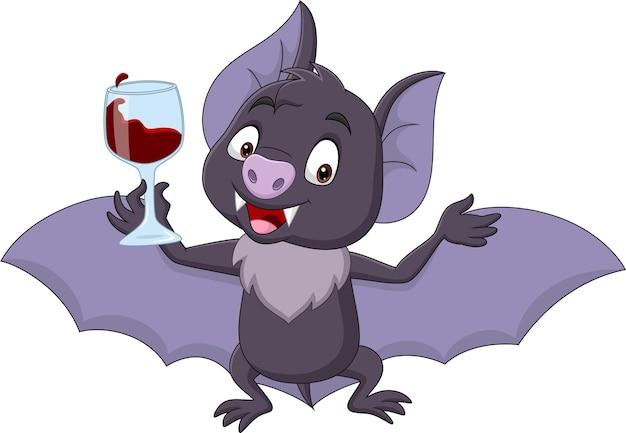 Pipistrello del fumetto che tiene un bicchiere di sangue