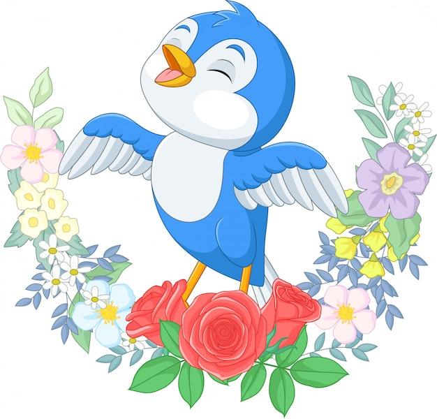 Uccello blu del fumetto che canta sul ramo di albero