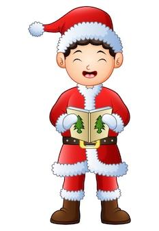 Ragazzo del fumetto che canta i canti natalizi isolati