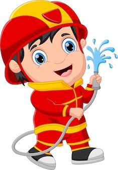 Ragazzo dei cartoni animati che indossa il costume da pompiere
