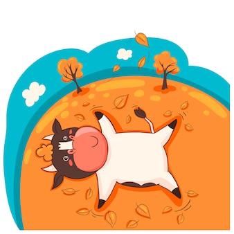 Personaggio dei cartoni animati toro sdraiato sulle foglie di autunno.