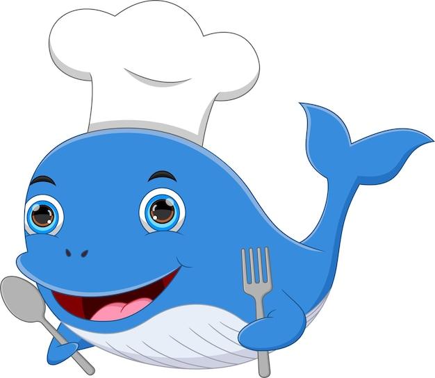 Cartone animato chef balena che tiene cucchiaio e forchetta