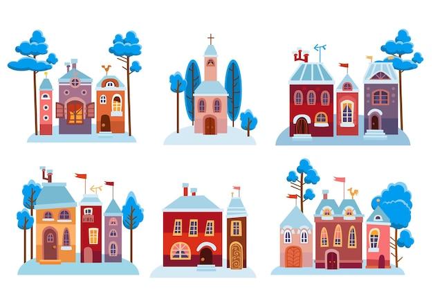 Set di case di natale dei cartoni animati. accogliente città invernale innevata.