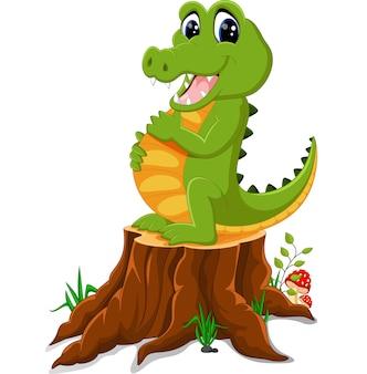 Coccodrillo del fumetto che posa sul ceppo di albero