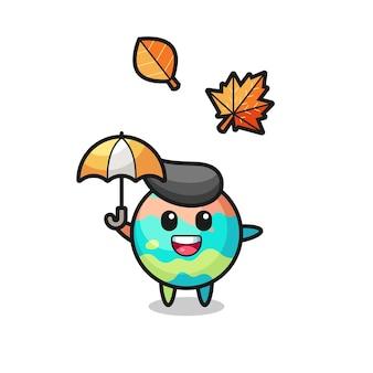 Cartone animato delle simpatiche bombe da bagno che tengono un ombrello in autunno, design in stile carino per maglietta, adesivo, elemento logo