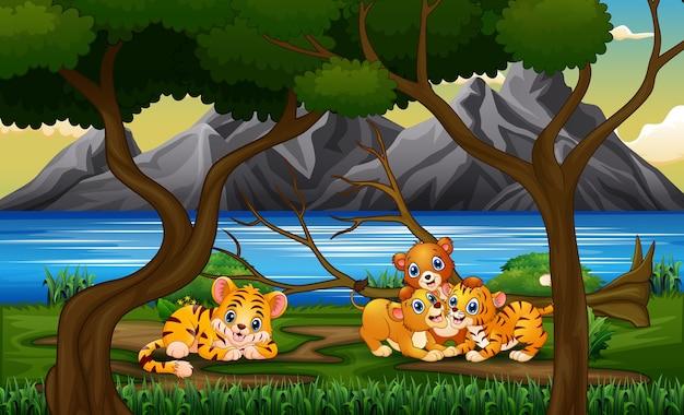 Cartoon un diversi animali che giocano in natura