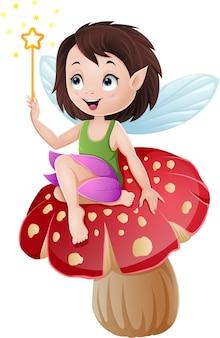 Fata del fumetto che si siede su un fungo