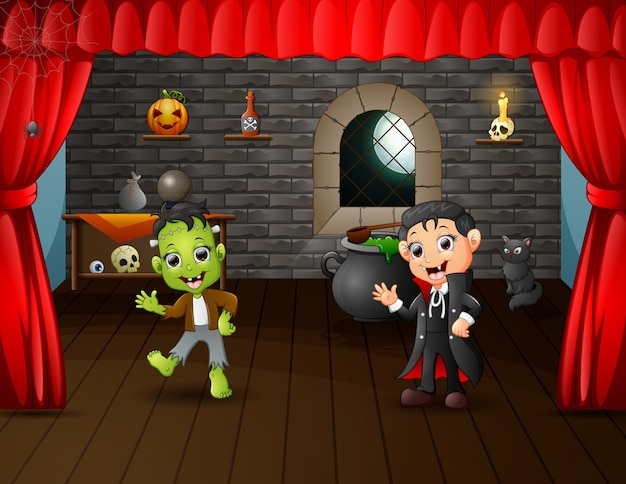 Cartone animato di frankenstein e vampiro sul palco