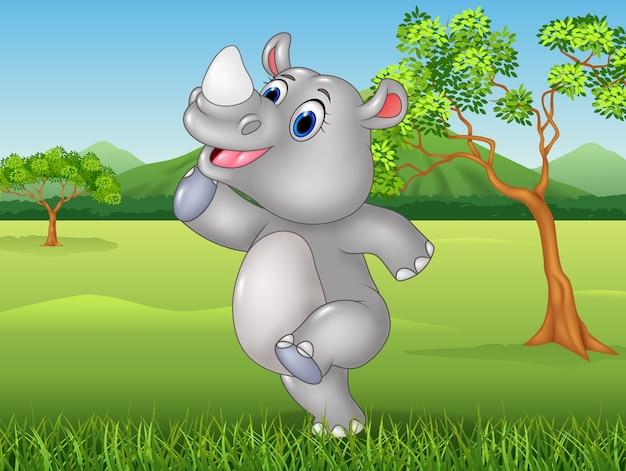 Rinoceronte divertente del fumetto che posa nella giungla