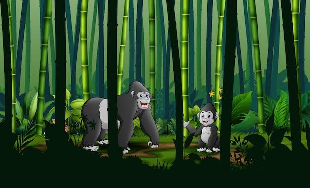 Cartone animato un gorilla con il suo cucciolo nella foresta di bambù
