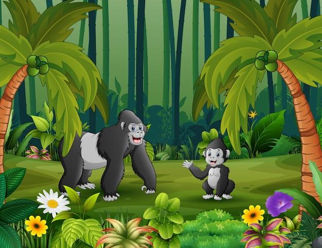 Cartone animato un gorilla con il suo cucciolo nella foresta