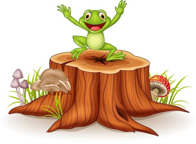 Rana felice del fumetto che salta sul ceppo di albero