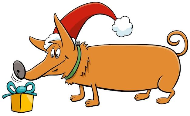 Illustrazione del fumetto del carattere animale del cane divertente con il regalo nel periodo natalizio
