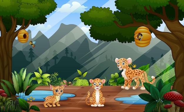 Illustrazione del fumetto dell'illustrazione della famiglia del ghepardo sullo sfondo della natura