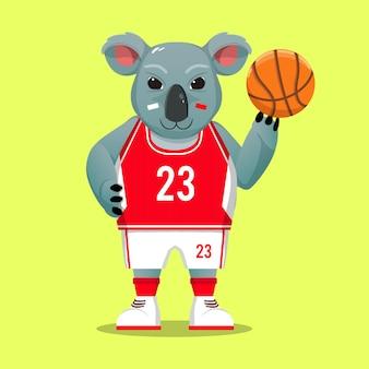 Mascotte del koala dei cartoni animati che indossa il costume sportivo da basket