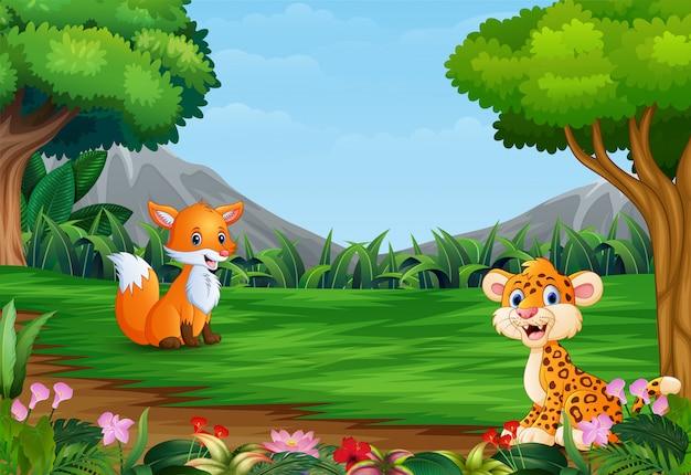 Cartone animato di leopardo e una volpe che giocano nella giungla