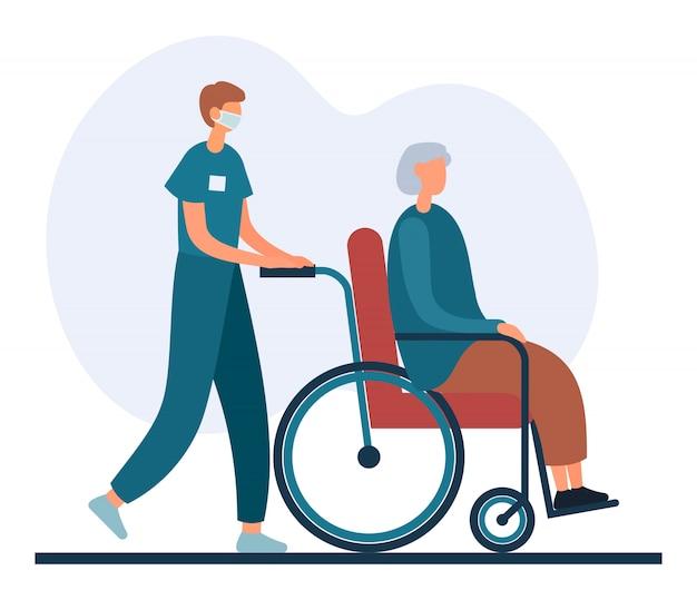 Infermiere maschio del fumetto che spinge sedia a rotelle con signora senior