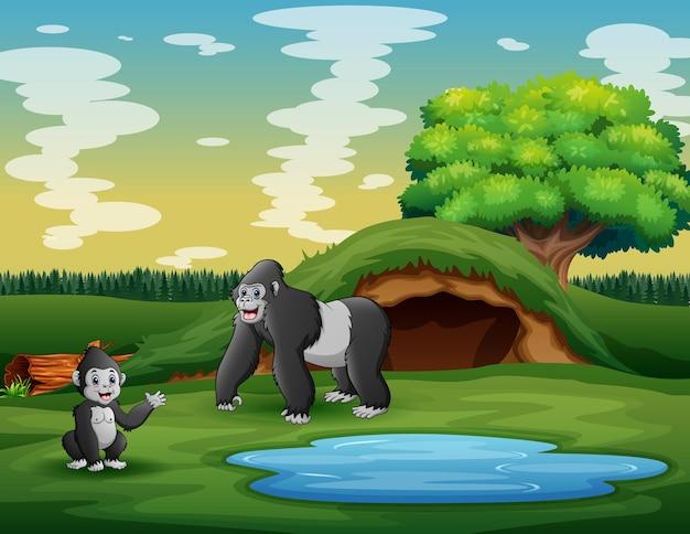 Cartone animato una madre gorilla con il suo cucciolo nel prato
