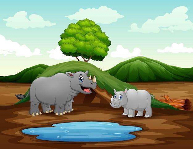 Cartone animato una madre rinoceronte con il suo cucciolo in natura
