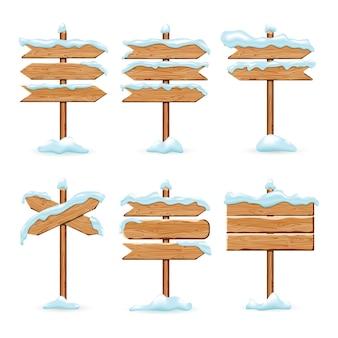 Cartelli in legno del fumetto con neve ghiacciata Vettore Premium