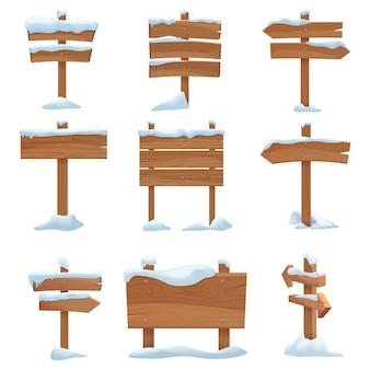 Cartelli invernali in legno del fumetto con tappi di neve impostati