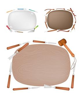 Strumenti di intaglio con tavola di legno, argilla e pietra