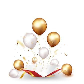 Celebrazione fuori con la scatola con coriandoli e palloncini d'oro