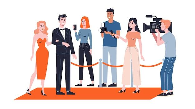 Coppia di celebrità sul tappeto rosso. paparazzi in piedi