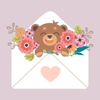 Il personaggio dell'orso carino nella lettera e l'illustrazione del fiore sul matrimonio