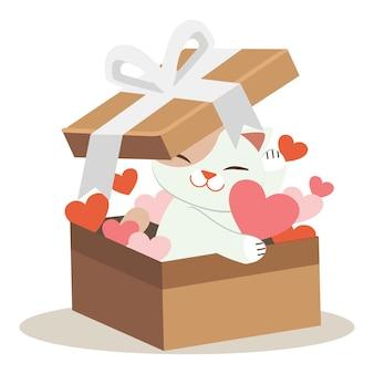 Il personaggio di un simpatico gatto che gioca un cuore nella grande scatola di carta.